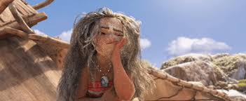Another scene from Disney's Moana, in which she wakes up, covered in sand, with disheveled hair, on Maui's island.