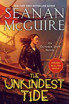 "The cover of ""The Unkindest Tide,"" by Seanan McGuire. A dark-haired woman, wearing a leather jacket, stands at a ship's railing, looking out at the sea."