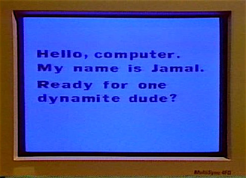 """Close-up of Jamal's computer screen, on which he's written: """"Hello, computer. My name is Jamal. Ready for one dynamite dude?"""""""