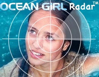 """My """"Ocean Girl Radar"""" logo: a picture of Neri, looking up at the viewer from the water, with a radar target in the foreground and the words """"Ocean Girl Radar TM"""" at the top."""