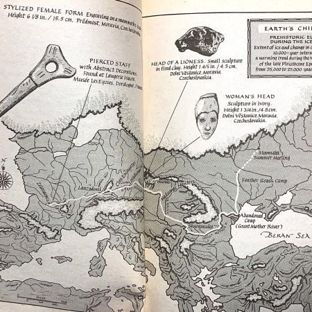 A black and white map of Ice Age Europe, from inside the book The Plains of Passage, by Jean M. Auel. There is a winding white line leading from the area now known as Ukraine to the area now known as France. There are also several images of Ice Age artifacts, such as carvings of women, a sculpture of a lioness head, and a pierced staff.
