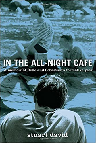 Cover of In the All-Night Cafe, by Stuart David.  The cover is a light-blue-tinted photograph of three people sitting by a rocky river.  One young man sits in the foreground, facing away from the camera.  The other two people sit, facing the left edge of the book, looking off into the distance.  One of them, a guy with very short hair, lies on his stomach, while the other, who could be a man or woman with short hair, is sitting up with one leg crossed over the other like the number four.  They all wear casual t-shirts -- the two guys plain, the third person a striped t-shirt and dark short-shorts.