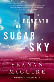 Cover of Beneath the Sugar Sky. A bright, blue sky covers the top left corner of the cover. Indigo clouds, with bright white lining, cover the top right. The bottom is occupied by magenta ocean waves crashing onto a magenta beach. In the middle of the sky is a semi-translucent door opening into nothingness.