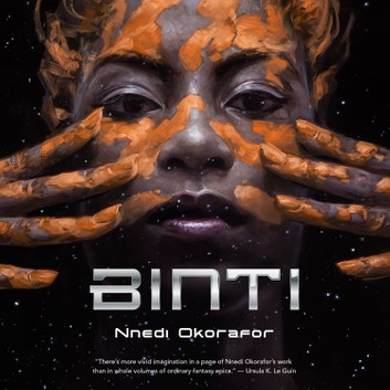Cover of the Binti audiobook. A dark background, in front of which you see a woman's face, with two hands spread open at either side of her face. She has dark skin, with streaks of red clay on both her face and her hands.