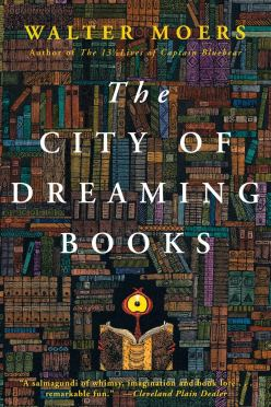 Cover of The City of Dreaming Books, by Walter Moers. The entire cover is filled with book spines stacked on shelves. At the bottom is a jagged black space in which a single book is opened, cover facing you. From behind the book, a small red eye-stalk sticks up, with a round yellow eye staring at you.