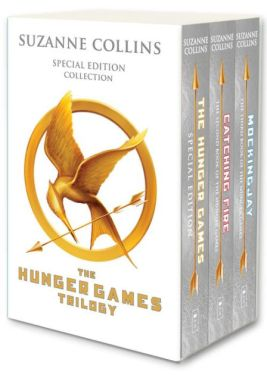 The Hunger Games box set. It's a plain white box with a golden Mockingjay symbol on the cover. It's a golden circle closely surrounding a bird in flight. The bird is curved in on itself so its long, thin beak almost touches its tail, which is shaped like a curved, upside-down V (almost like the Star Trek insignia). In the bird's beak is a long, thin arrow that cuts diagonally across the bottom half of the circle.