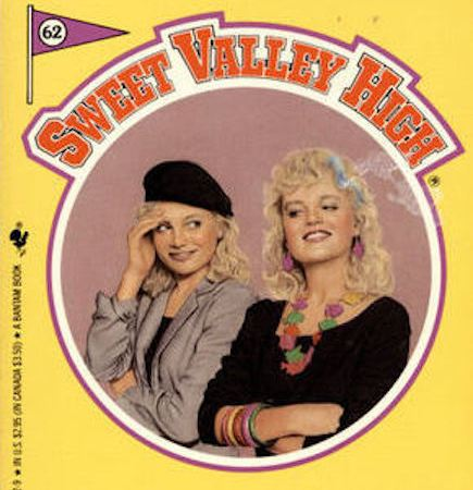 "Cropped image of the buttery yellow cover of SVH book 62, ""Who's Who?"" The red, letter-jacket-style series title curves around a circle in the center of the cover. Inside the circle, Elizabeth and Jessica stand against a pinkish-brown background. Elizabeth, on the left, is wearing a grey dinner jacket on top of a black top or dress that cuts straight across the chest. She's wearing a black beret over curly, pale blond hair. Her left arm is folded across her middle, supporting her right elbow. Her right hand is shading her right eye, like she's exasperated or embarrassed, and she's looking over her shoulder at Jessica, with an amusedly embarrassed smile. Jessica, meanwhile, is grinning confidently to the lower-left corner of the book, her arms crossed to show a series of multicolored bangles. She's wearing a simple, three-quarter-sleeved black dress punctuated by a wild statement necklace made up of multicolored fish. She has a pale blue streak in her curly, pale-blond hair. The tag-line under the circle reads: ""Will the real Jessica please stand up?"" and the book title is in large purple letters at the bottom of the cover."