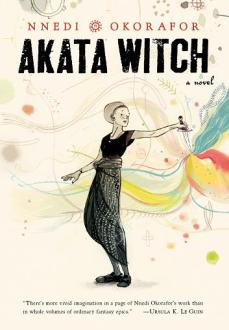 Cover of Akata Witch, by Nnedi Okorafor.  The background is manila-colored.  In the foreground is a black-and-white sketch of a girl whose body is facing the left edge of the cover, while her head is turned to look behind her.  Her right arm is slightly stretched forward, while her left arm is stretched behind her, holding a dagger blade-side down.  Several colors -- blue, red, and yellow -- stream out from the point of the dagger.