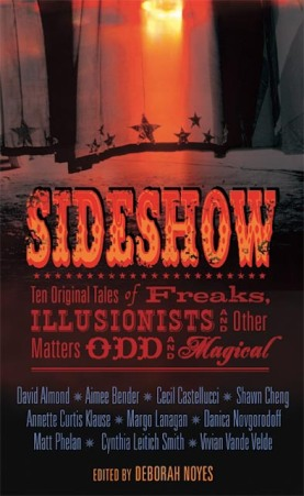 Cover of Sideshow, edited by Deborah Noyes. The title is a molten, flaming red, in a Wild West font, in the middle of the cover. Below it, in the same font, is the darker red subtitle: Ten Original Tales of Freaks, Illusionists, and Other Matters Odd and Magical. Under that, in blue, are the ten authors included in the book. The background is a deep fiery red at the top, shifting into black on the bottom half of the cover. In the red section, you can see a curtain bordered with black stars at the bottom, with a golden light shining through the upper-middle part of the cover.