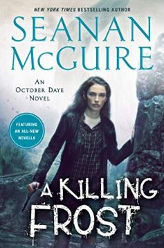 Cover of A Killing Frost, by Seanan McGuire. Toby Daye stands in what looks like the foggy ruins of a cathedral. She is leaning against the stone frames of a doorway, left arm bent like a V and right arm straight, facing the viewer. Her long dark hair is loose and she's wearing her trademark black leather jacket on top of a black V-neck top.