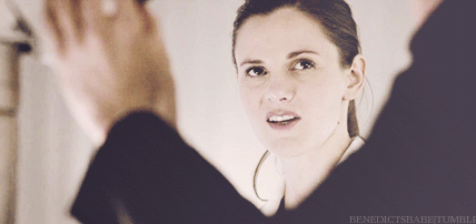 Image of Molly Hooper, from BBC Sherlock, staring at Sherlock, unimpressed. You can only see Sherlock's bent arm in a black sleeve. You see Molly's head in the middle of the V made by Sherlock's arm.