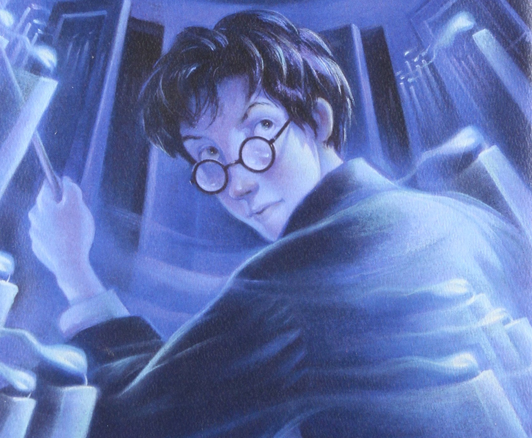 Close-up of the Scholastic cover of Harry Potter and the Order of the Phoenix.  Everything is in shades of blue.  You see Harry looking over his left shoulder, toward the audience, a very serious expression on his face, wand lefted vertically in his left fist.