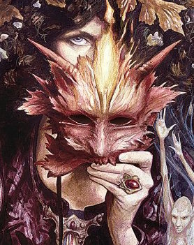 Section break image.  A woman with pale skin and dark hair hides behind an autumnal red and gold goblin mask.  Only her right eye peeks out from above the mask, and the left hand that holds it is decorated with a single ruby or garnet ring on the fourth finger.    There are pale bronze leaves bordering her face, and a spindly, parchment-white faery peeks out from the bottom-right corner of the image, sticking their arms straight up to touch the mask.