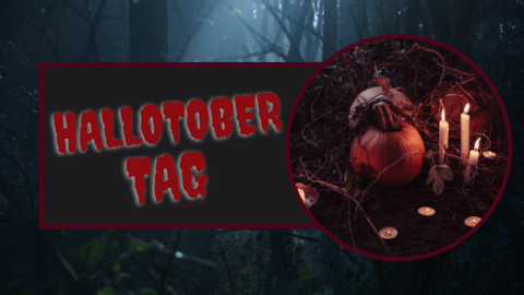 "The Hallotober Tag image.  It's very dark.  In the background, you see a few silhouettes of thin forest trees just barely lit up by a weak, bluish beam of moonlight.  In the foreground is a horizontal black rectangle with a thin, dark red border.  The words ""Hallotober Tag"" are written in dark red inside the rectangle.  Covering the very right side of the rectangle is a large black circle with a dark red border.  Inside are what look like too pumpkins, one a medium orange and one a dark orange, or maybe the second one is just in shadow.  They sit on some kind of table, surrounded by tea lights and tall candles."