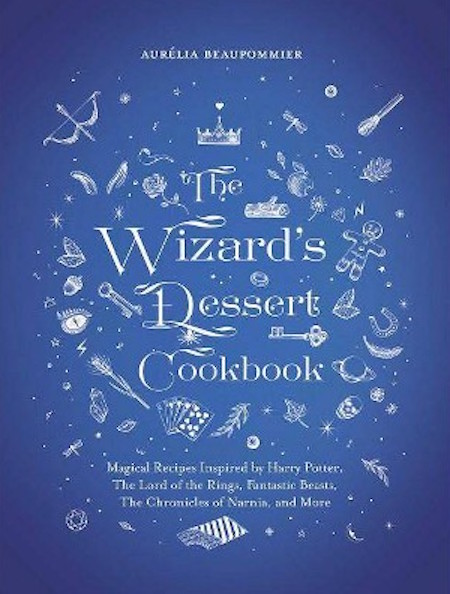 Cover of The Wizard's Dessert Cookbook, by Aurelia Beaupommier.  Subtitle: Magical REcipes Inspired by Harry Potter, The Lord of the Rings, Fantastic Beasts, The Chronicles of NArnia, and More.  The cover is blue, with the title in white, surrounded by more ghostly white images, including: a thistle, a gingerbread man, a set of playing cards, a bow and arrow, a crown, a key, Saturn, and more.