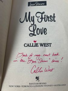 """Photo of the My First Love title page.  There's a magenta heart inked over the i in """"Callie West,"""" and  her signature reads, """"Look for my next book in the Love Stories series!"""""""