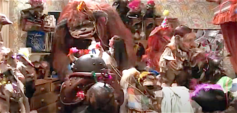 Screenshot from the end of Jim Henson's Labyrinth, when all the muppets are partying in Jennifer Connolly's room after she defeats the Goblin King.