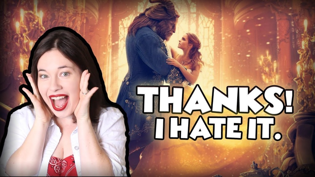 """Title card for Lindsey Ellis' review of Disney's Beauty and the Beast remake.  The review is titled """"Thanks! I hate it.""""  You see Emma Watson dancing with the Beast in the background.  In the foreground, Lindsey smiles sarcastically while holding her hands on either side of her face, like she's really screaming."""